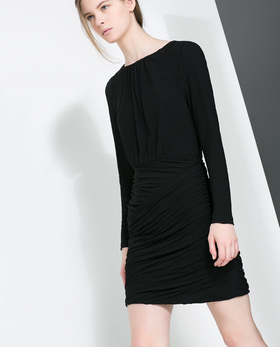 Short Draped Dress - style: shift; length: mid thigh; pattern: plain; predominant colour: black; occasions: casual, evening, occasion, creative work; fit: body skimming; fibres: polyester/polyamide - stretch; neckline: crew; hip detail: ruching/gathering at hip; sleeve length: long sleeve; sleeve style: standard; pattern type: fabric; texture group: jersey - stretchy/drapey; trends: gothic romance; season: a/w 2013