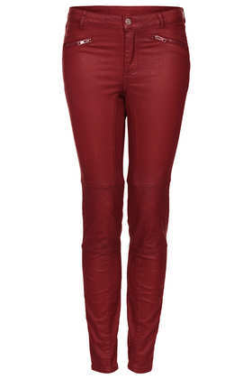 Red Coated Biker Trousers - length: standard; pattern: plain; pocket detail: traditional 5 pocket; waist: mid/regular rise; predominant colour: burgundy; occasions: casual, evening, creative work; fibres: cotton - stretch; texture group: cotton feel fabrics; fit: skinny/tight leg; pattern type: fabric; style: standard; trends: broody brights; season: a/w 2013