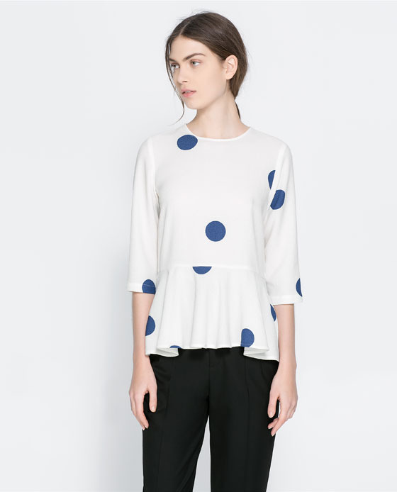Polka Dot Peplum Blouse - style: blouse; pattern: polka dot; waist detail: peplum waist detail; predominant colour: white; secondary colour: royal blue; occasions: casual, evening, creative work; length: standard; fibres: polyester/polyamide - stretch; fit: body skimming; neckline: crew; sleeve length: 3/4 length; sleeve style: standard; pattern type: fabric; pattern size: standard; texture group: jersey - stretchy/drapey; season: a/w 2013