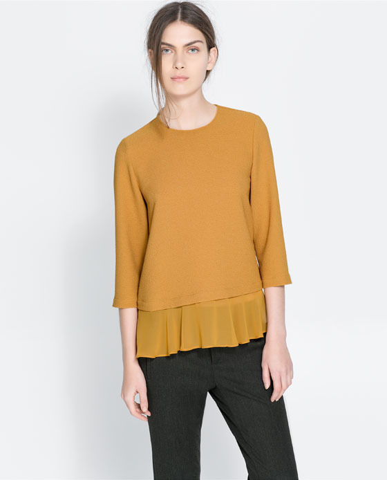 Blouse With Frilled Hem - pattern: plain; predominant colour: mustard; occasions: casual, evening, work, creative work; length: standard; style: top; fibres: polyester/polyamide - stretch; fit: loose; neckline: crew; sleeve length: 3/4 length; sleeve style: standard; texture group: crepes; hip detail: ruffles/tiers/tie detail at hip; season: a/w 2013