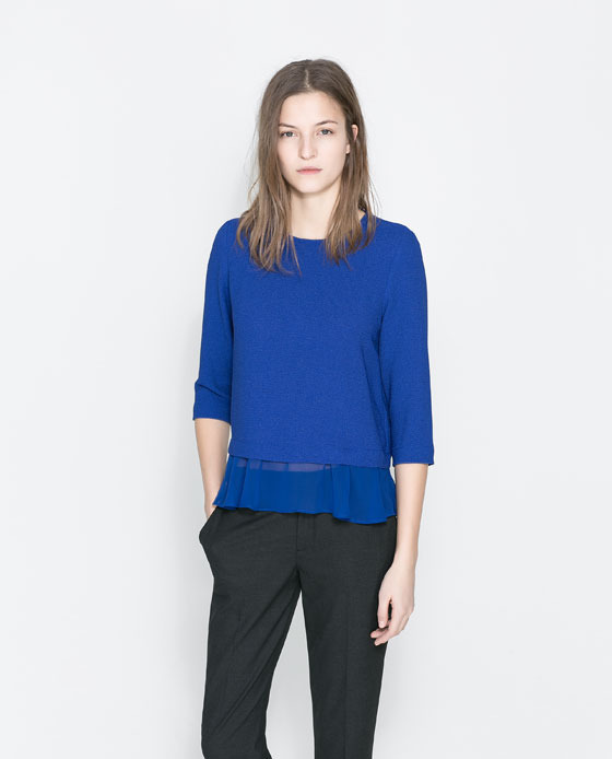 Blouse With Frilled Hem - pattern: plain; predominant colour: royal blue; occasions: casual, evening, work, creative work; length: standard; style: top; fibres: polyester/polyamide - stretch; fit: loose; neckline: crew; sleeve length: 3/4 length; sleeve style: standard; texture group: crepes; season: a/w 2013