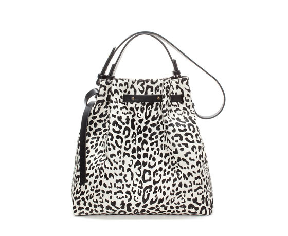 Two Tone Furry And Leather Bucket Bag - secondary colour: white; predominant colour: black; occasions: casual, creative work; type of pattern: standard; style: shoulder; length: shoulder (tucks under arm); size: standard; material: leather; pattern: animal print; trends: monochrome; finish: plain; season: a/w 2013