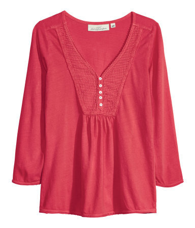 Jersey Top - neckline: low v-neck; pattern: plain; bust detail: buttons at bust (in middle at breastbone)/zip detail at bust; predominant colour: true red; occasions: casual, creative work; length: standard; style: top; fibres: cotton - 100%; fit: loose; sleeve length: 3/4 length; sleeve style: standard; pattern type: fabric; texture group: jersey - stretchy/drapey; season: a/w 2013