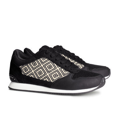 Sneakers - secondary colour: white; predominant colour: black; occasions: casual, creative work; material: fabric; heel height: flat; embellishment: studs; toe: round toe; style: trainers; finish: plain; pattern: patterned/print; season: a/w 2013; trends: monochrome