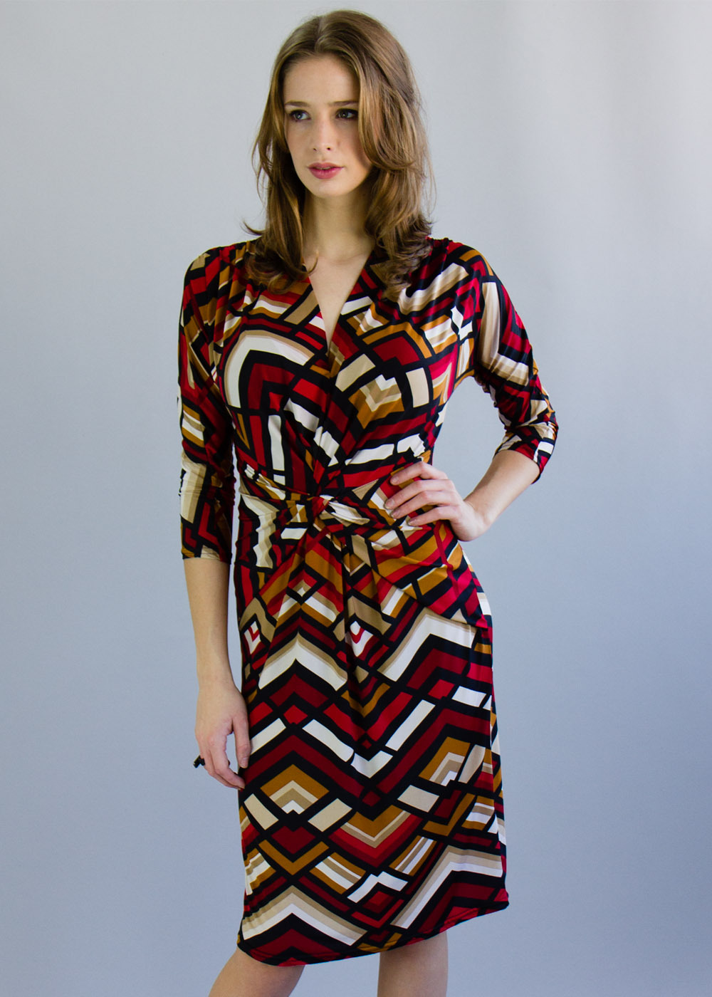 Aztec Dress - style: faux wrap/wrap; length: below the knee; neckline: v-neck; waist detail: flattering waist detail; predominant colour: true red; secondary colour: mustard; occasions: casual, creative work; fit: body skimming; fibres: viscose/rayon - stretch; sleeve length: 3/4 length; sleeve style: standard; pattern type: fabric; pattern size: big & busy; pattern: patterned/print; texture group: jersey - stretchy/drapey; season: a/w 2013