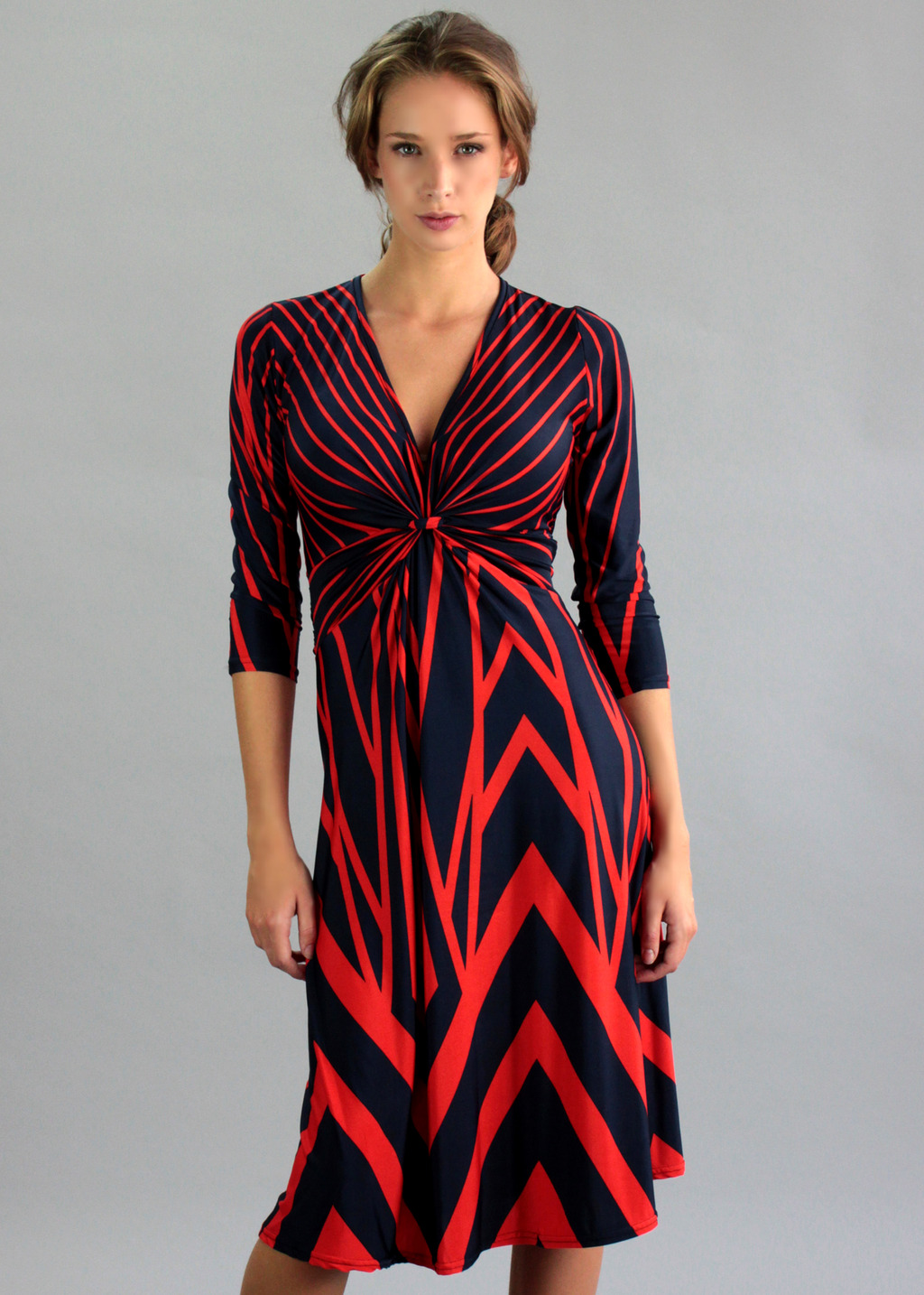 Shard Dress - style: empire line; length: below the knee; neckline: low v-neck; fit: loose; bust detail: knot twist front detail at bust; predominant colour: true red; secondary colour: navy; occasions: casual, evening, creative work; fibres: polyester/polyamide - stretch; sleeve length: 3/4 length; sleeve style: standard; pattern type: fabric; pattern size: big & busy; pattern: patterned/print; texture group: jersey - stretchy/drapey; season: a/w 2013