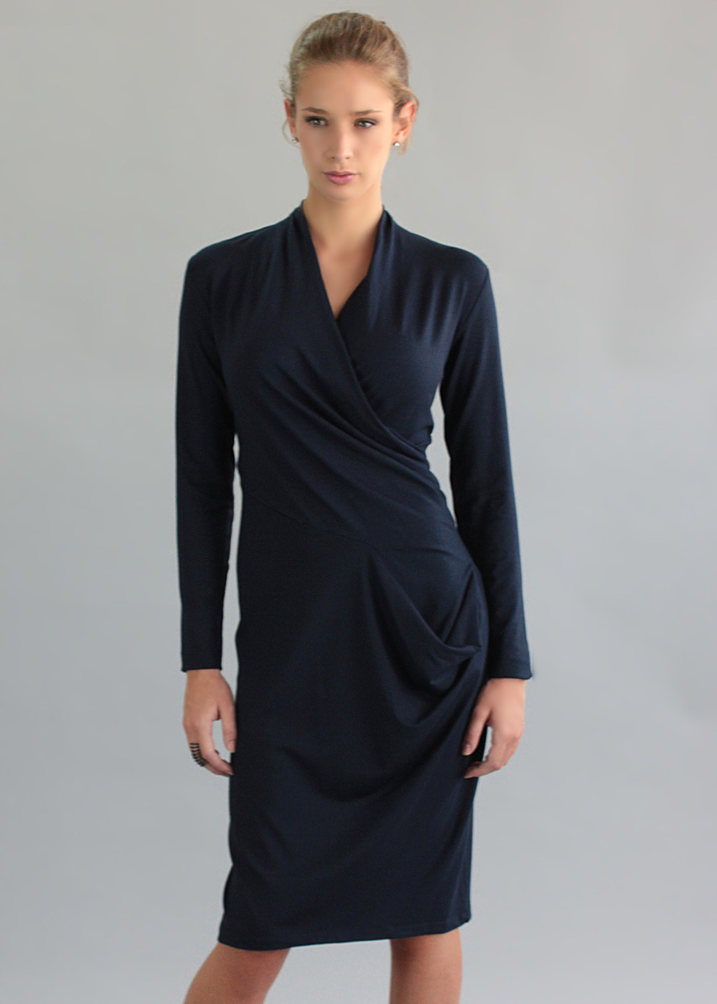 Chelsea Dress - style: faux wrap/wrap; length: below the knee; neckline: v-neck; pattern: plain; predominant colour: navy; occasions: evening, occasion, creative work; fit: body skimming; fibres: viscose/rayon - stretch; hip detail: soft pleats at hip/draping at hip/flared at hip; sleeve length: long sleeve; sleeve style: standard; pattern type: fabric; texture group: jersey - stretchy/drapey; trends: broody brights; season: a/w 2013
