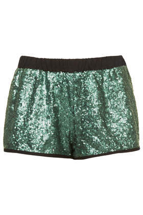 Emerald Sequin Runner Shorts - pattern: plain; waist detail: elasticated waist; waist: mid/regular rise; predominant colour: dark green; occasions: casual, evening, holiday, creative work; fibres: polyester/polyamide - 100%; pattern type: fabric; texture group: other - light to midweight; embellishment: sequins; season: a/w 2013; style: hot pants; length: short shorts; fit: slim leg; wardrobe: highlight; embellishment location: all over