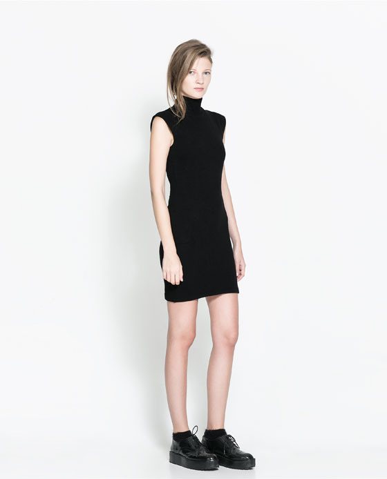 Lace Dress - length: mid thigh; fit: tight; pattern: plain; sleeve style: sleeveless; neckline: high neck; style: bodycon; back detail: back revealing; predominant colour: black; occasions: casual, evening, occasion, creative work; sleeve length: sleeveless; texture group: jersey - clingy; pattern type: fabric; fibres: viscose/rayon - mix; season: a/w 2013; wardrobe: basic