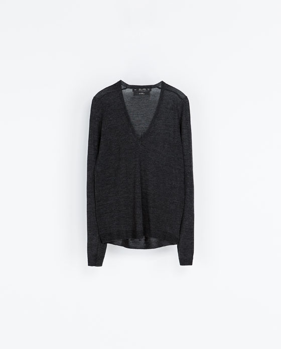 Merino Wool Sweater - neckline: low v-neck; pattern: plain; style: standard; predominant colour: black; occasions: casual, work, creative work; length: standard; fibres: wool - 100%; fit: loose; back detail: longer hem at back than at front; sleeve length: long sleeve; sleeve style: standard; texture group: knits/crochet; pattern type: knitted - fine stitch; season: a/w 2013