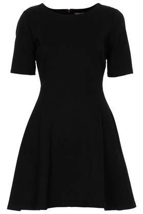 A Line Skater Dress - length: mid thigh; neckline: round neck; pattern: plain; predominant colour: black; occasions: casual, evening, work, creative work; fit: fitted at waist & bust; style: fit & flare; fibres: viscose/rayon - stretch; sleeve length: short sleeve; sleeve style: standard; texture group: jersey - stretchy/drapey; season: a/w 2013