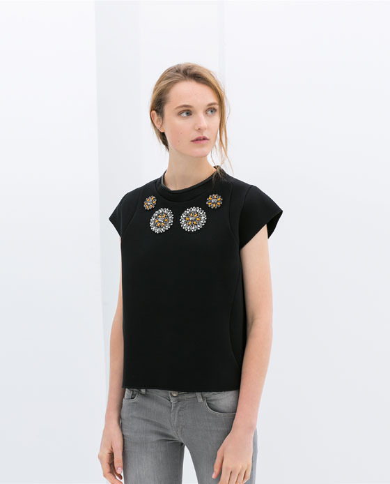 Technical Fabric Top With Jewel - pattern: plain; bust detail: added detail/embellishment at bust; predominant colour: black; occasions: casual, evening, work, creative work; length: standard; style: top; fibres: viscose/rayon - 100%; fit: straight cut; neckline: crew; sleeve length: short sleeve; sleeve style: standard; texture group: technical outdoor fabrics; pattern type: fabric; embellishment: beading; season: s/s 2014