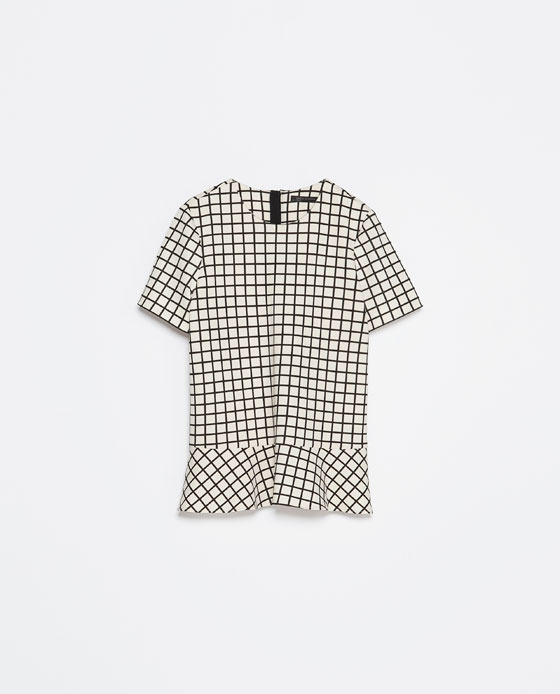 Checked Top - neckline: round neck; pattern: checked/gingham; waist detail: peplum waist detail; secondary colour: white; predominant colour: black; occasions: casual, evening, work, creative work; length: standard; style: top; fibres: polyester/polyamide - stretch; fit: straight cut; back detail: keyhole/peephole detail at back; sleeve length: short sleeve; sleeve style: standard; texture group: cotton feel fabrics; pattern type: fabric; pattern size: standard; season: s/s 2014; trends: monochrome