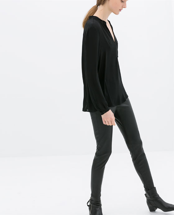 Leggings - length: standard; pattern: plain; style: leggings; waist: mid/regular rise; predominant colour: black; occasions: casual, evening, creative work; fibres: polyester/polyamide - 100%; texture group: leather; fit: skinny/tight leg; pattern type: fabric; season: s/s 2014