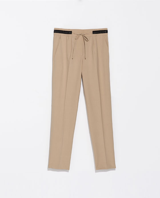 Wool Trousers - pattern: plain; waist detail: belted waist/tie at waist/drawstring; waist: mid/regular rise; predominant colour: nude; occasions: casual, creative work; length: ankle length; fibres: polyester/polyamide - stretch; fit: tapered; pattern type: fabric; texture group: woven light midweight; style: standard; season: s/s 2014