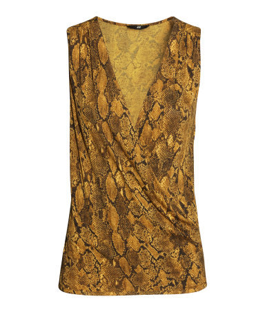 Draped Top - neckline: v-neck; sleeve style: sleeveless; style: wrap/faux wrap; predominant colour: gold; occasions: casual, evening, occasion, creative work; length: standard; fibres: viscose/rayon - 100%; fit: body skimming; sleeve length: sleeveless; pattern type: fabric; pattern: animal print; texture group: jersey - stretchy/drapey; season: s/s 2014