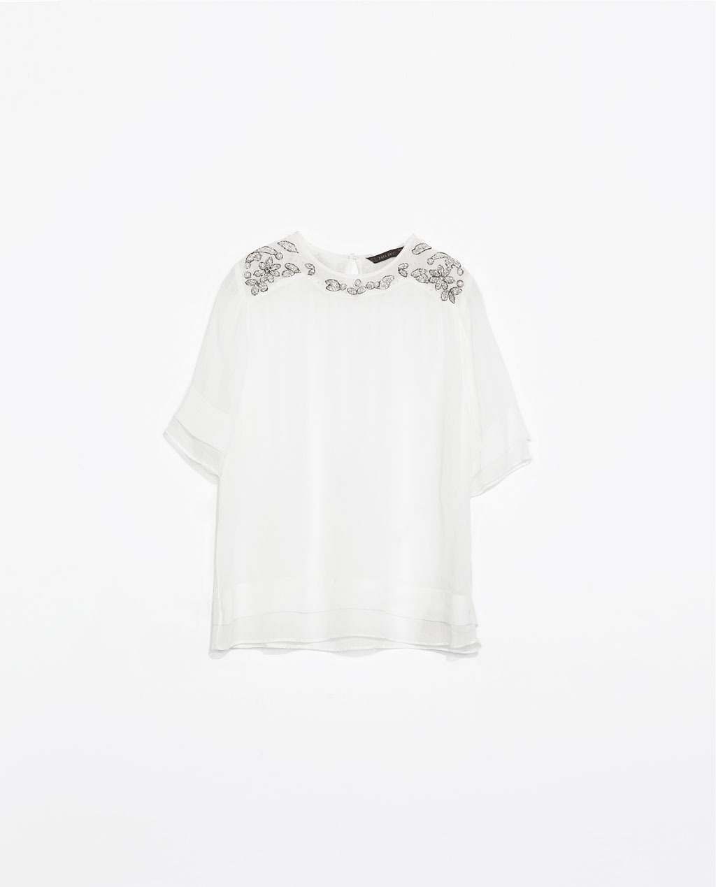 Top - neckline: round neck; pattern: plain; style: t-shirt; predominant colour: white; occasions: casual, evening, occasion, creative work; length: standard; fibres: viscose/rayon - 100%; fit: loose; shoulder detail: added shoulder detail; sleeve length: short sleeve; sleeve style: standard; texture group: sheer fabrics/chiffon/organza etc.; pattern type: fabric; embellishment: crystals/glass; trends: summer sparkle, sheer; season: s/s 2014