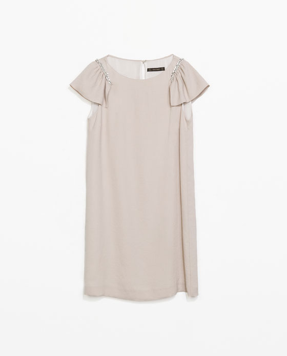 Dress With Chain Shoulder - style: tunic; length: mid thigh; neckline: round neck; sleeve style: capped; pattern: plain; predominant colour: stone; occasions: casual, evening, occasion, holiday, creative work; fit: straight cut; fibres: polyester/polyamide - 100%; sleeve length: short sleeve; pattern type: fabric; texture group: other - light to midweight; embellishment: chain/metal; trends: sorbet shades; season: s/s 2014