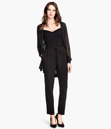 Trousers Loose Fit - length: standard; pattern: plain; style: harem/slouch; waist: high rise; pocket detail: pockets at the sides; waist detail: belted waist/tie at waist/drawstring; predominant colour: black; occasions: casual, evening, work, creative work; fibres: polyester/polyamide - 100%; texture group: crepes; fit: tapered; pattern type: fabric; season: s/s 2014