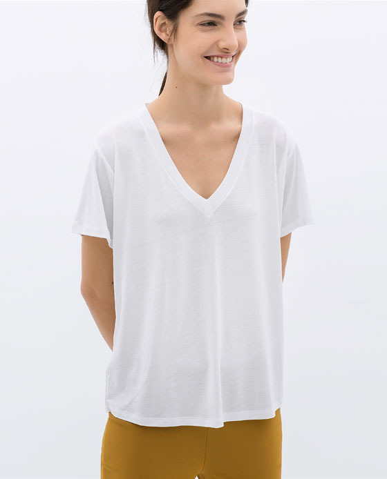V Neck T Shirt - neckline: v-neck; pattern: plain; style: t-shirt; predominant colour: white; occasions: casual, holiday, creative work; length: standard; fibres: polyester/polyamide - 100%; fit: straight cut; sleeve length: short sleeve; sleeve style: standard; pattern type: fabric; texture group: jersey - stretchy/drapey; season: s/s 2014