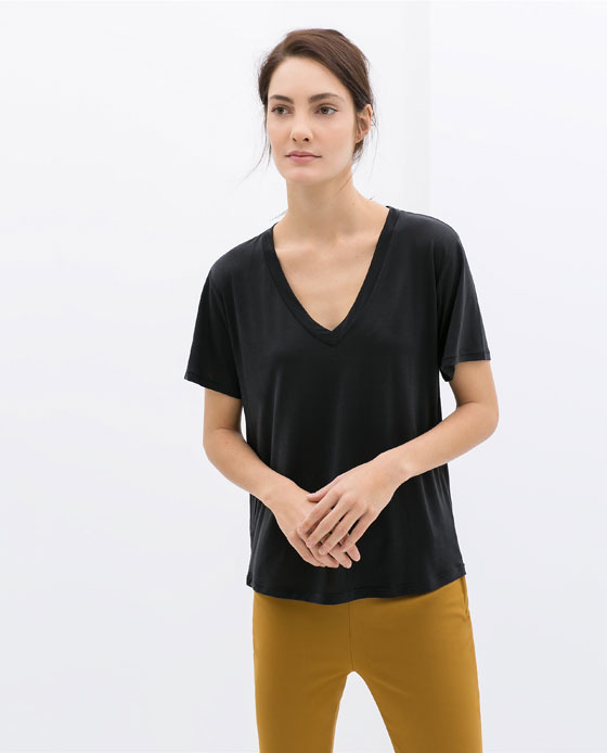 V Neck T Shirt - neckline: low v-neck; pattern: plain; style: t-shirt; predominant colour: black; occasions: casual, holiday, creative work; length: standard; fibres: viscose/rayon - 100%; fit: straight cut; sleeve length: short sleeve; sleeve style: standard; pattern type: fabric; texture group: jersey - stretchy/drapey; season: s/s 2014