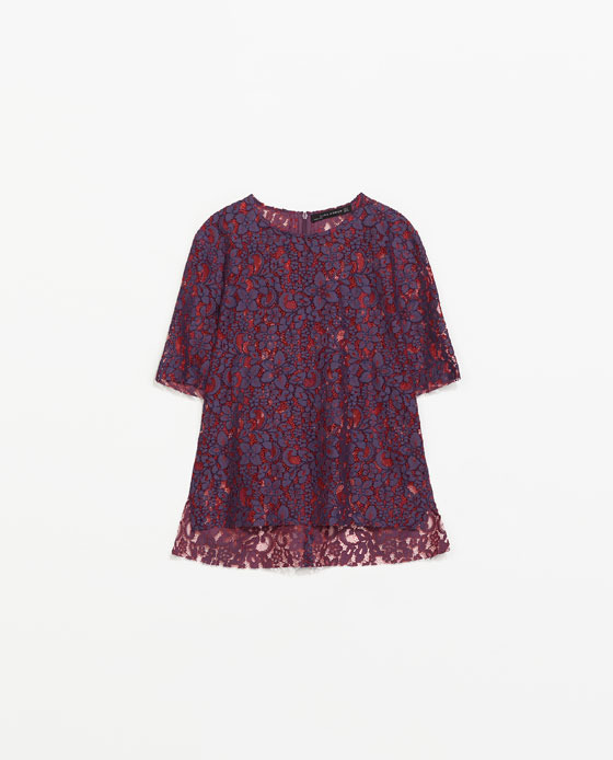 Lace Top With Asymmetric Hem - predominant colour: purple; occasions: casual, evening, occasion, creative work; length: standard; style: top; fibres: cotton - mix; fit: straight cut; neckline: crew; sleeve length: short sleeve; sleeve style: standard; texture group: lace; pattern type: fabric; pattern: patterned/print; trends: lace; season: s/s 2014