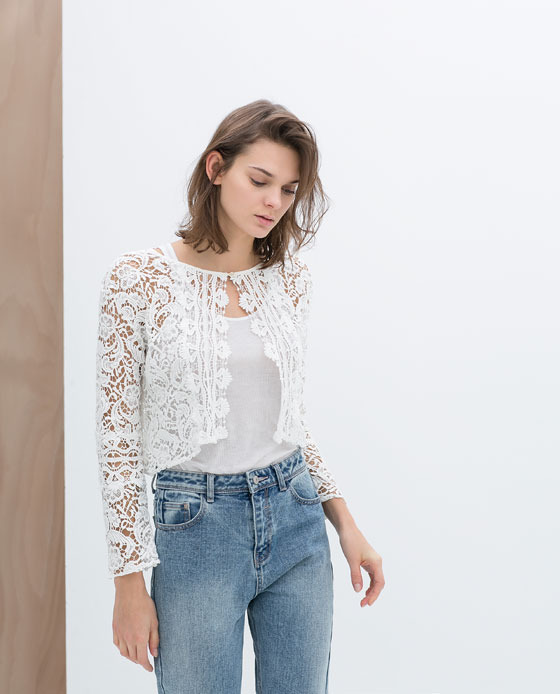 Lace Jacket - style: cropped; collar: round collar/collarless; predominant colour: ivory/cream; occasions: casual, holiday, creative work; fit: straight cut (boxy); fibres: cotton - 100%; sleeve length: long sleeve; sleeve style: standard; texture group: lace; collar break: high/illusion of break when open; pattern type: fabric; pattern: patterned/print; trends: lace; season: s/s 2014; length: cropped