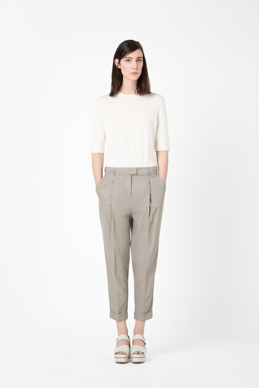 Relaxed Pleated Trousers - pattern: plain; pocket detail: small back pockets, pockets at the sides; style: peg leg; waist: mid/regular rise; predominant colour: khaki; occasions: casual, work, creative work; length: ankle length; fibres: cotton - mix; jeans & bottoms detail: turn ups; fit: tapered; texture group: woven light midweight; season: s/s 2014