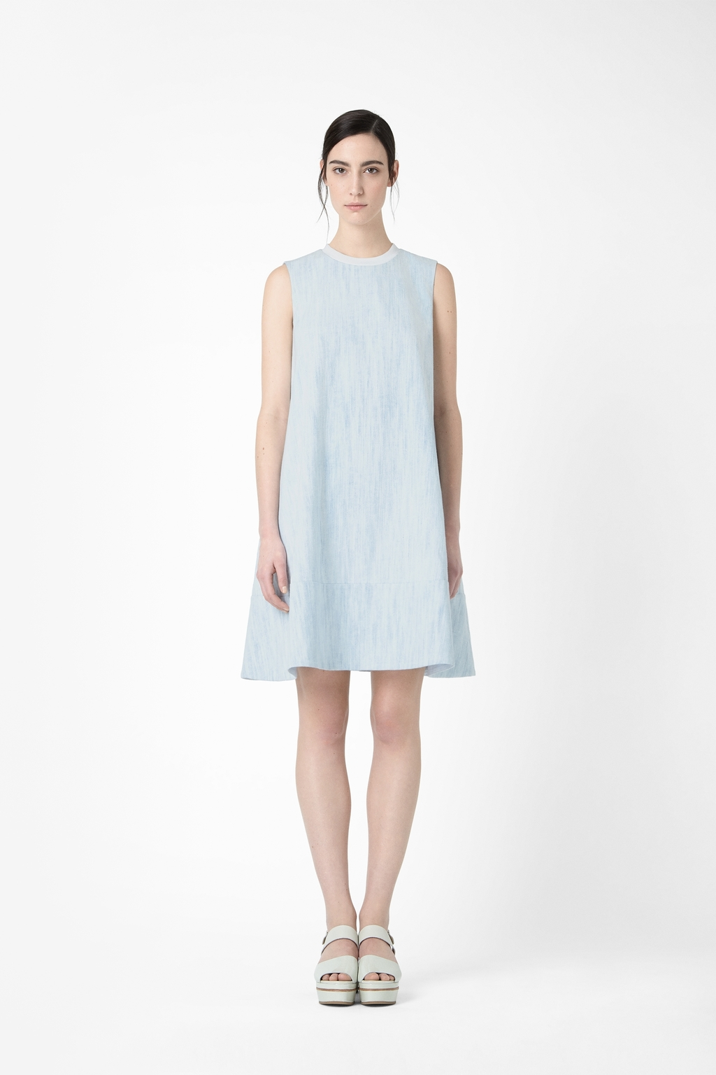 A Line Denim Dress - style: shift; pattern: plain; sleeve style: sleeveless; predominant colour: pale blue; occasions: casual, holiday, creative work; length: just above the knee; fit: soft a-line; fibres: cotton - 100%; neckline: crew; sleeve length: sleeveless; texture group: denim; pattern type: fabric; trends: sorbet shades; season: s/s 2014