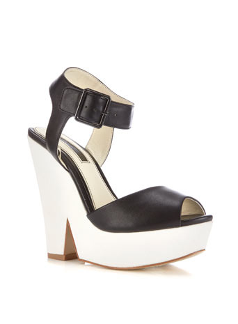 Madrid Split Wedge - secondary colour: white; predominant colour: black; occasions: casual, holiday, creative work; material: faux leather; ankle detail: ankle strap; heel: wedge; toe: open toe/peeptoe; style: standard; finish: plain; pattern: colourblock; heel height: very high; shoe detail: platform; season: s/s 2014; trends: monochrome