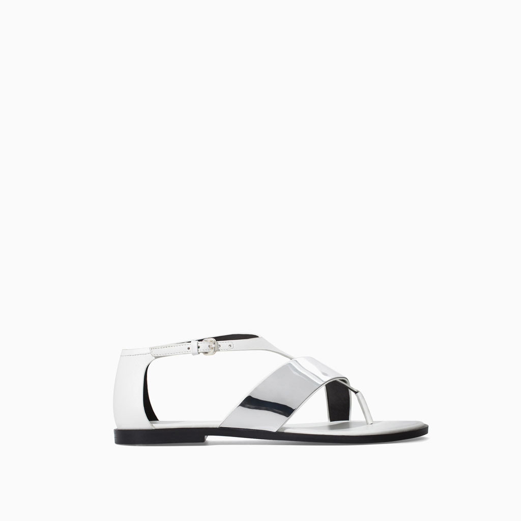 Metallic Flat Leather Sandal - predominant colour: silver; occasions: casual; material: leather; heel height: flat; ankle detail: ankle strap; heel: standard; toe: toe thongs; style: strappy; finish: metallic; pattern: plain; season: s/s 2014