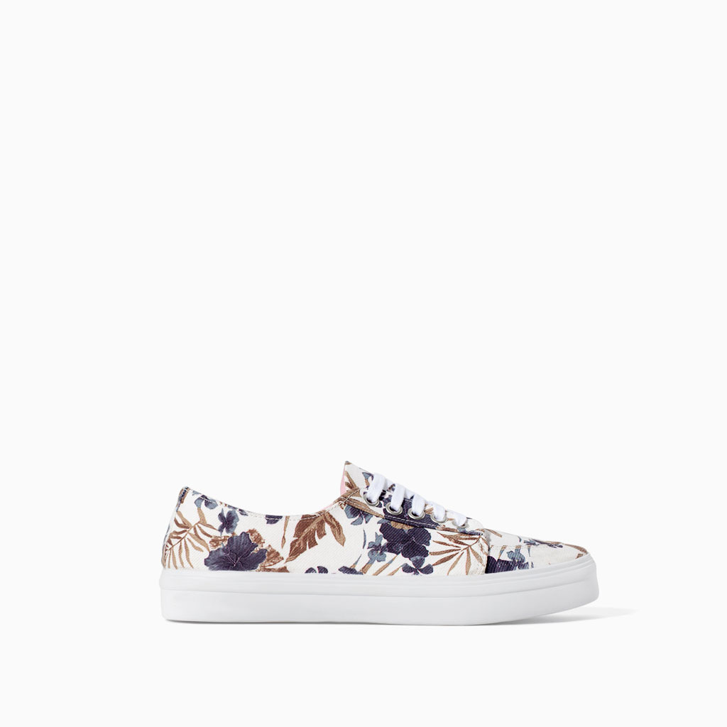Floral Plimsoll - predominant colour: white; secondary colour: navy; occasions: casual, holiday, creative work; material: fabric; heel height: flat; toe: round toe; style: trainers; finish: plain; pattern: florals; shoe detail: platform; trends: furious florals; season: s/s 2014