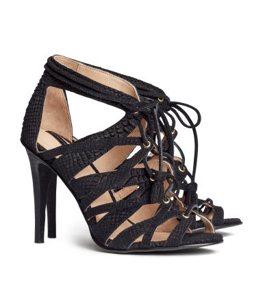 Suede Sandals - predominant colour: black; occasions: evening, occasion, holiday, creative work; material: suede; heel height: high; embellishment: tassels; ankle detail: ankle strap; heel: stiletto; toe: open toe/peeptoe; style: strappy; finish: plain; pattern: plain; season: s/s 2014