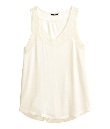 Lace Top - sleeve style: wide vest straps; neckline: low v-neck; pattern: plain; style: vest top; predominant colour: ivory/cream; occasions: casual; length: standard; fibres: viscose/rayon - 100%; fit: loose; bust detail: contrast pattern/fabric/detail at bust; back detail: longer hem at back than at front; sleeve length: sleeveless; pattern type: fabric; texture group: jersey - stretchy/drapey; embellishment: lace; season: s/s 2014