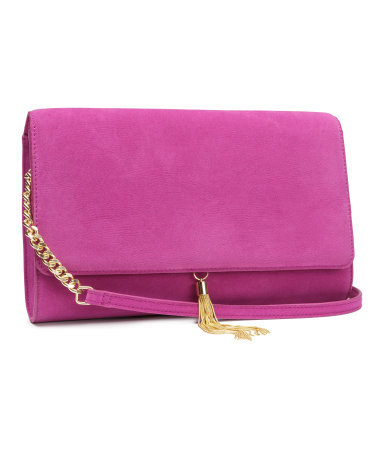 Shoulder Bag - predominant colour: hot pink; secondary colour: gold; occasions: casual, evening, occasion, holiday, creative work; style: shoulder; length: shoulder (tucks under arm); size: standard; embellishment: tassels; pattern: plain; finish: plain; material: faux suede; trends: hot brights; season: s/s 2014