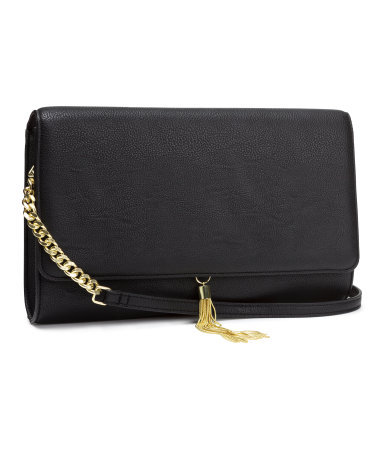 Shoulder Bag - secondary colour: gold; predominant colour: black; occasions: casual, evening, occasion, holiday, creative work; type of pattern: standard; style: shoulder; length: shoulder (tucks under arm); size: standard; material: faux leather; embellishment: tassels; pattern: plain; finish: plain; season: s/s 2014
