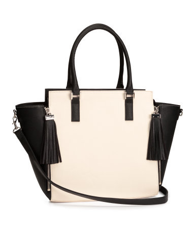 Handbag - predominant colour: ivory/cream; secondary colour: black; occasions: casual, work, creative work; type of pattern: standard; style: tote; length: handle; size: standard; material: faux leather; embellishment: tassels; finish: plain; pattern: colourblock; season: s/s 2014