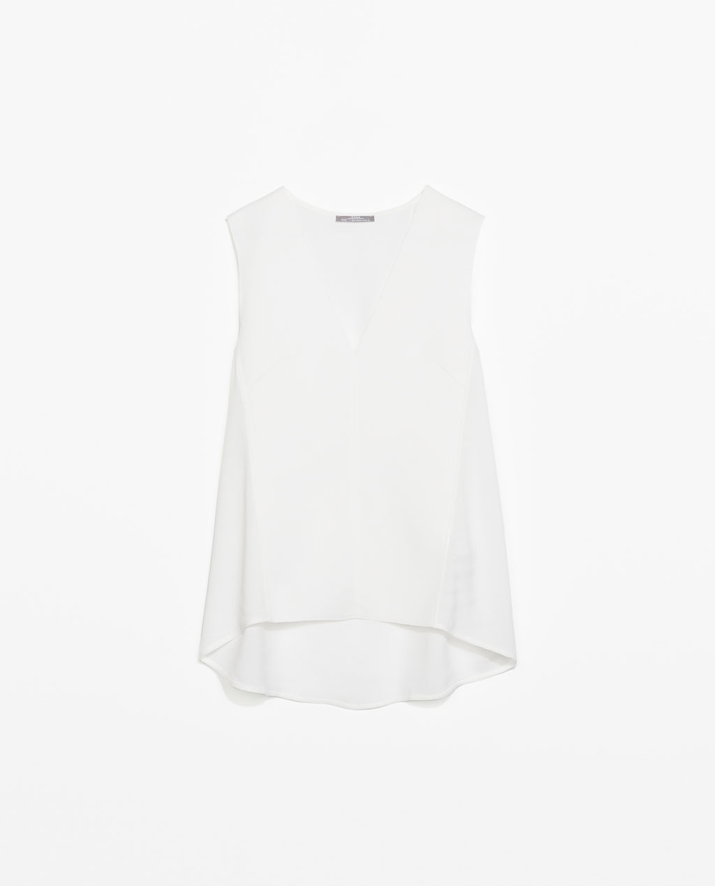V Neck Top - neckline: low v-neck; pattern: plain; sleeve style: sleeveless; style: vest top; predominant colour: white; occasions: casual, creative work; length: standard; fibres: viscose/rayon - 100%; fit: loose; back detail: longer hem at back than at front; sleeve length: sleeveless; texture group: crepes; pattern type: fabric; season: s/s 2014