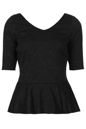 Jaquard Peplum Top - neckline: low v-neck; pattern: plain; back detail: low cut/open back; waist detail: peplum waist detail; predominant colour: black; occasions: casual, evening; length: standard; style: top; fibres: cotton - 100%; fit: tailored/fitted; sleeve length: short sleeve; sleeve style: standard; pattern type: fabric; texture group: brocade/jacquard; season: s/s 2014
