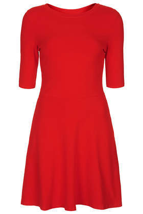 Clean Flippy Tunic - length: mid thigh; neckline: round neck; pattern: plain; predominant colour: true red; occasions: casual, evening, creative work; fit: fitted at waist & bust; style: fit & flare; fibres: cotton - 100%; hip detail: subtle/flattering hip detail; sleeve length: half sleeve; sleeve style: standard; pattern type: fabric; texture group: jersey - stretchy/drapey; season: s/s 2014