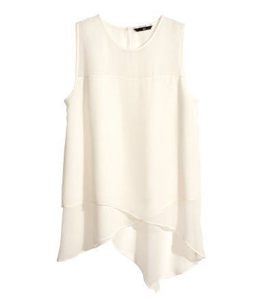 Chiffon Top - neckline: round neck; pattern: plain; sleeve style: sleeveless; predominant colour: ivory/cream; occasions: casual, evening, work, creative work; length: standard; style: top; fibres: polyester/polyamide - 100%; fit: loose; hip detail: dip hem; sleeve length: sleeveless; texture group: sheer fabrics/chiffon/organza etc.; pattern type: fabric; season: s/s 2014