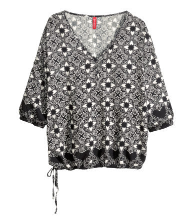 Patterned Blouse - neckline: low v-neck; style: blouson; secondary colour: white; predominant colour: black; occasions: casual; length: standard; fibres: viscose/rayon - 100%; fit: loose; sleeve length: 3/4 length; sleeve style: standard; hip detail: ruffles/tiers/tie detail at hip; pattern type: fabric; pattern size: standard; pattern: patterned/print; texture group: woven light midweight; season: s/s 2014; trends: monochrome