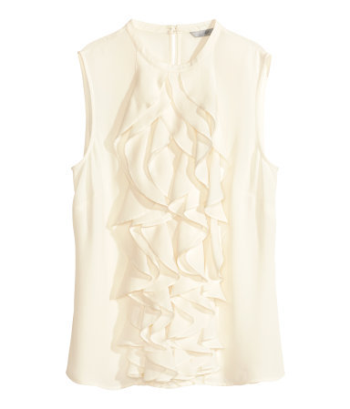 Frilled Blouse - pattern: plain; sleeve style: sleeveless; predominant colour: white; occasions: evening, work, occasion, creative work; length: standard; style: top; fibres: polyester/polyamide - 100%; fit: body skimming; neckline: crew; sleeve length: sleeveless; texture group: sheer fabrics/chiffon/organza etc.; bust detail: tiers/frills/bulky drapes/pleats; pattern type: fabric; season: s/s 2014