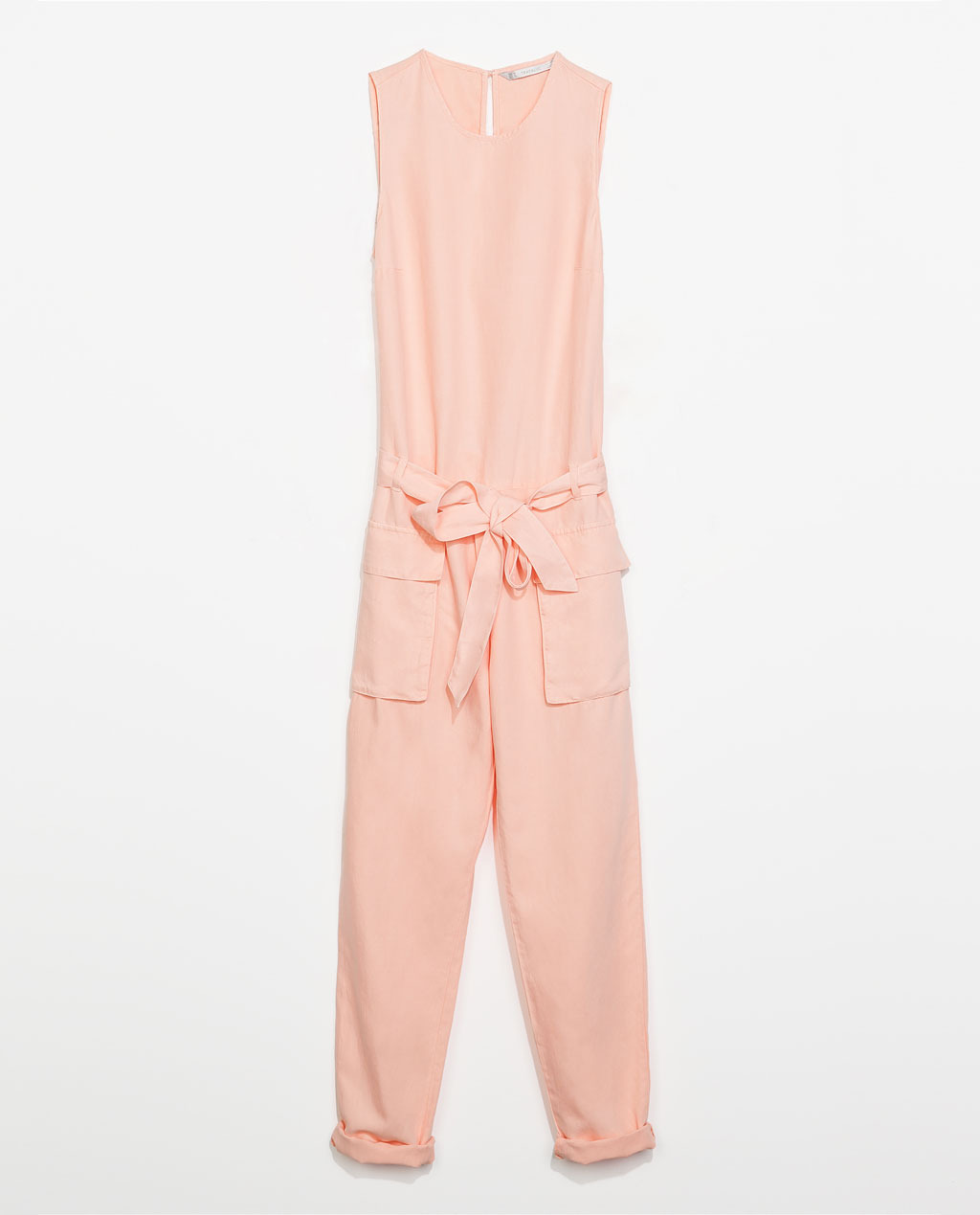 Sleeveless Jumpsuit - neckline: round neck; pattern: plain; sleeve style: sleeveless; waist detail: belted waist/tie at waist/drawstring; predominant colour: nude; occasions: casual, evening, creative work; length: ankle length; fit: straight cut; fibres: viscose/rayon - stretch; hip detail: front pleats at hip level; sleeve length: sleeveless; texture group: cotton feel fabrics; style: jumpsuit; pattern type: fabric; trends: sorbet shades; season: s/s 2014