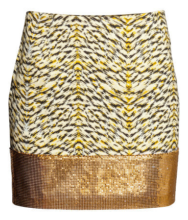 Patterned Skirt - length: mini; fit: tailored/fitted; waist: mid/regular rise; secondary colour: primrose yellow; predominant colour: gold; occasions: evening, occasion, holiday; style: mini skirt; fibres: cotton - mix; hip detail: added detail/embellishment at hip; texture group: cotton feel fabrics; pattern type: fabric; pattern: animal print; trends: world traveller, shimmery metallics; season: s/s 2014; pattern size: big & busy (bottom)