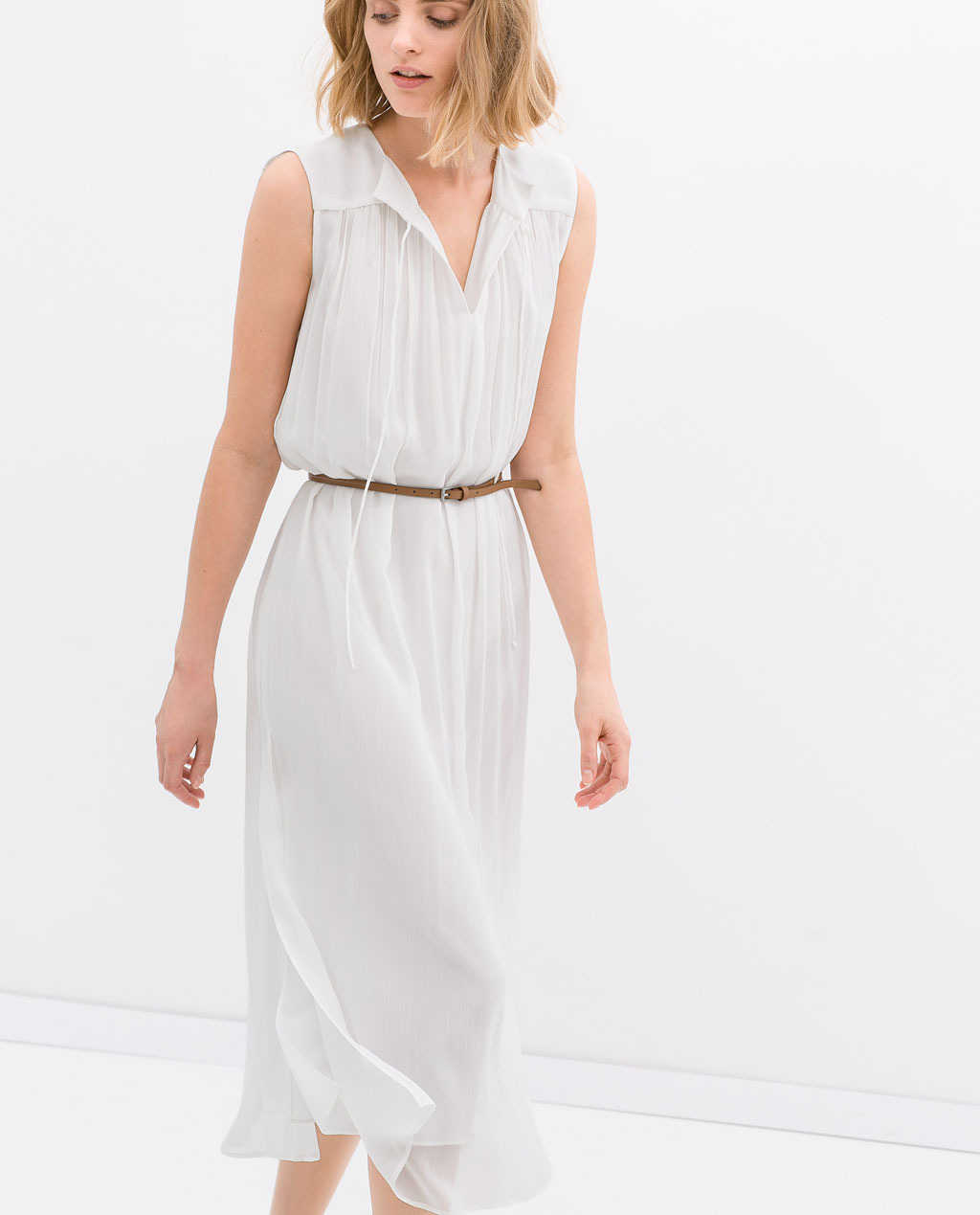 Long Dress With Belt - style: tea dress; length: calf length; neckline: v-neck; fit: fitted at waist; pattern: plain; sleeve style: sleeveless; waist detail: belted waist/tie at waist/drawstring; predominant colour: white; occasions: casual, holiday, creative work; fibres: viscose/rayon - 100%; sleeve length: sleeveless; texture group: sheer fabrics/chiffon/organza etc.; pattern type: fabric; season: s/s 2014