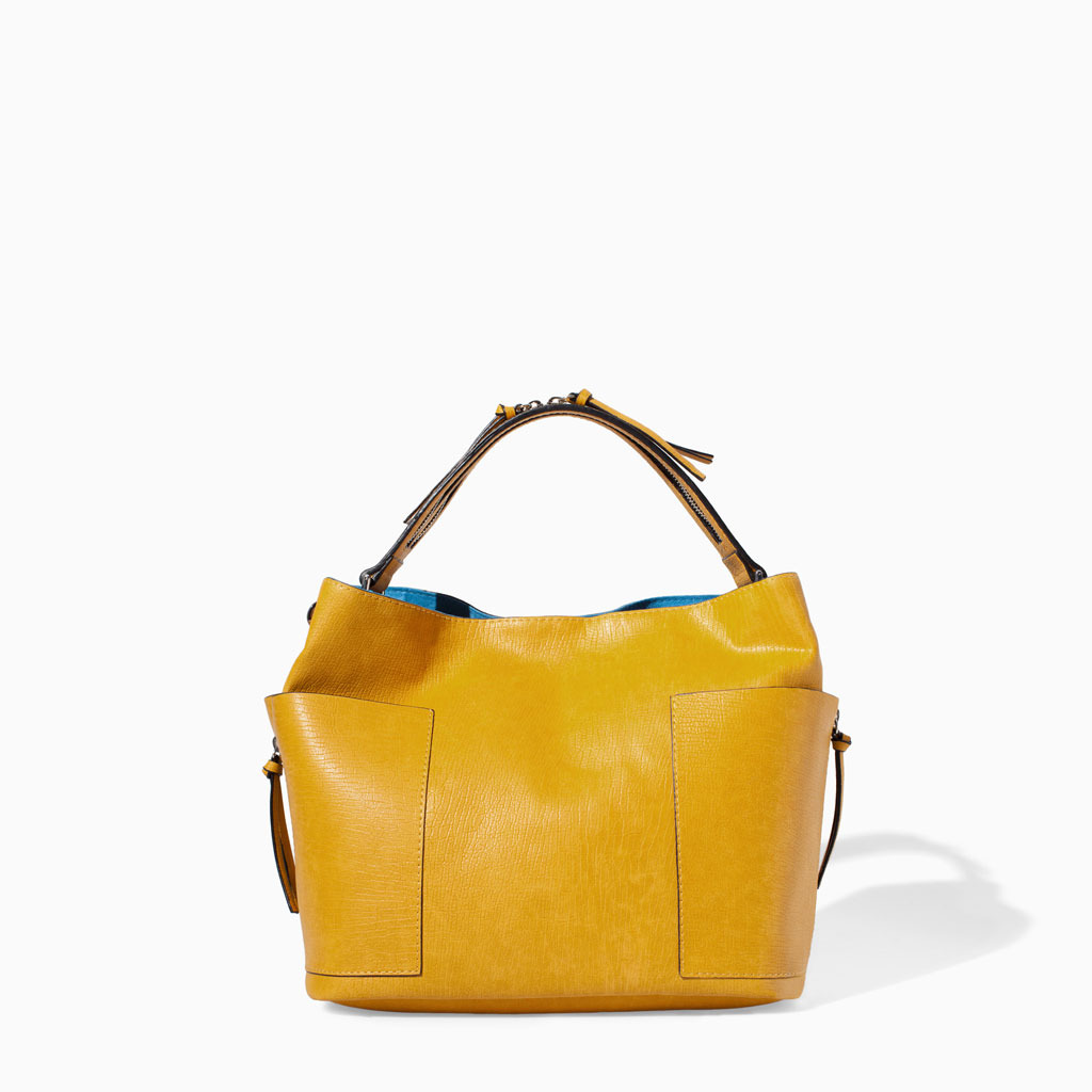 Bucket Bag With Zip - predominant colour: mustard; occasions: casual, creative work; style: tote; length: shoulder (tucks under arm); size: standard; pattern: plain; finish: plain; material: pvc; trends: hot brights; season: s/s 2014