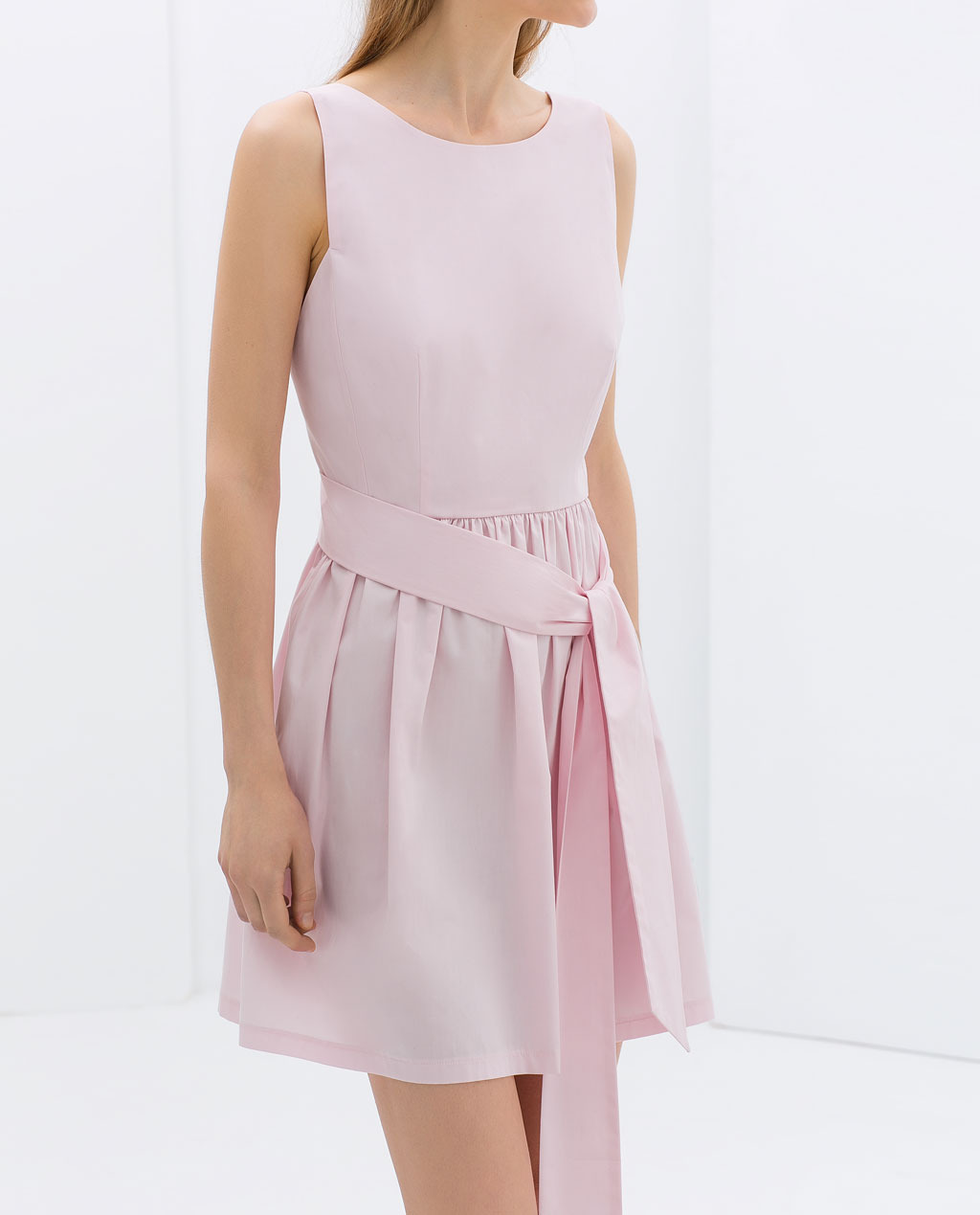Poplin Dress With Bow At The Back - length: mid thigh; neckline: round neck; pattern: plain; sleeve style: sleeveless; back detail: back revealing; waist detail: belted waist/tie at waist/drawstring; predominant colour: blush; occasions: casual, evening, holiday, creative work; fit: fitted at waist & bust; style: fit & flare; fibres: cotton - 100%; sleeve length: sleeveless; texture group: cotton feel fabrics; hip detail: ruffles/tiers/tie detail at hip; pattern type: fabric; trends: sorbet shades; season: s/s 2014