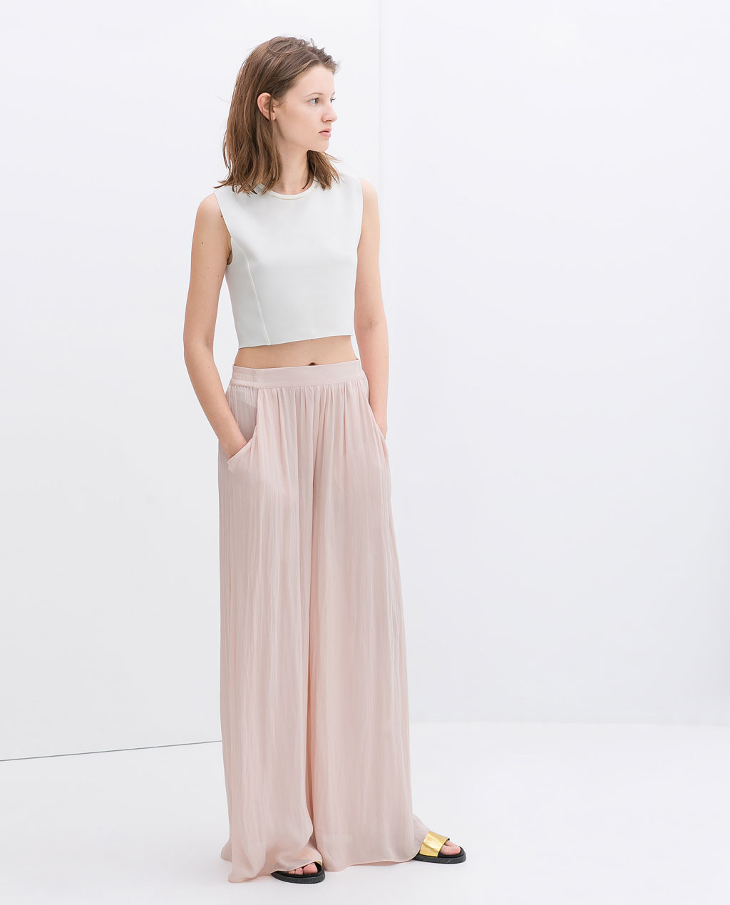 Wide Palazzo Trousers - length: standard; pattern: plain; style: palazzo; waist detail: elasticated waist; pocket detail: pockets at the sides; waist: mid/regular rise; predominant colour: blush; occasions: casual, holiday; fibres: polyester/polyamide - 100%; texture group: sheer fabrics/chiffon/organza etc.; fit: wide leg; pattern type: fabric; trends: sorbet shades; season: s/s 2014