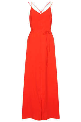 Strappy Cross Back Maxi Dress - neckline: low v-neck; sleeve style: spaghetti straps; fit: fitted at waist; pattern: plain; style: maxi dress; waist detail: belted waist/tie at waist/drawstring; predominant colour: true red; occasions: casual, evening; length: floor length; fibres: polyester/polyamide - 100%; sleeve length: sleeveless; texture group: crepes; pattern type: fabric; trends: hot brights; season: s/s 2014